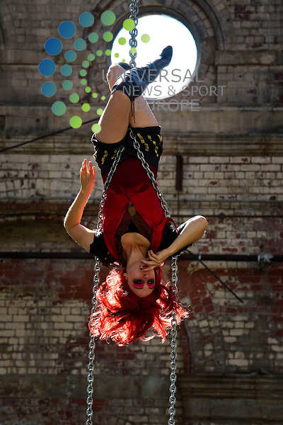 Paper Dolls MIlitia from the USA to perform a dark aerial fairy tale in Industrial Leith as part of Leith on the Fringe, Edinburgh, Scotland, 5th August 2011, PIctured Sarah Bebe Holmes (red) and Rain Anya (white).Picture:Scott Taylor Universal News And Sport (Europe) .All pictures must be credited to www.universalnewsandsport.com. (Office)0844 884 51 22.
