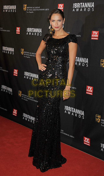 Asha Leo.BAFTA Los Angeles 2011 Britannia Awards held at the Beverly Hilton Hotel, Beverly Hills, California, USA..November 30th, 2011.full length black dress sequins sequined hand on hip .CAP/ROT/TM.©Tony Michaels/Roth Stock/Capital Pictures