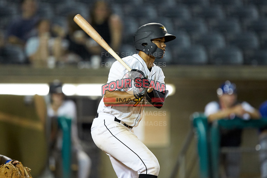 Calvin Mitchell (34) of the West Virginia Power follows through on his swing against the Lexington Legends at Appalachian Power Park on June 7, 2018 in Charleston, West Virginia. The Power defeated the Legends 5-1. (Brian Westerholt/Four Seam Images)