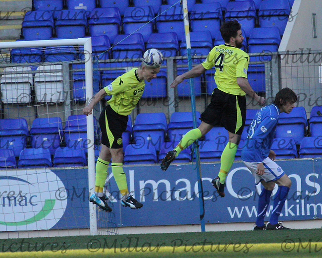 Jim Goodwin heads the ball missed by teammate Darren McGregor and Murray Davidson in the St Johnstone v St Mirren Scottish Professional Football League Premiership match played at McDiarmid Park, Perth on 11.1.14.