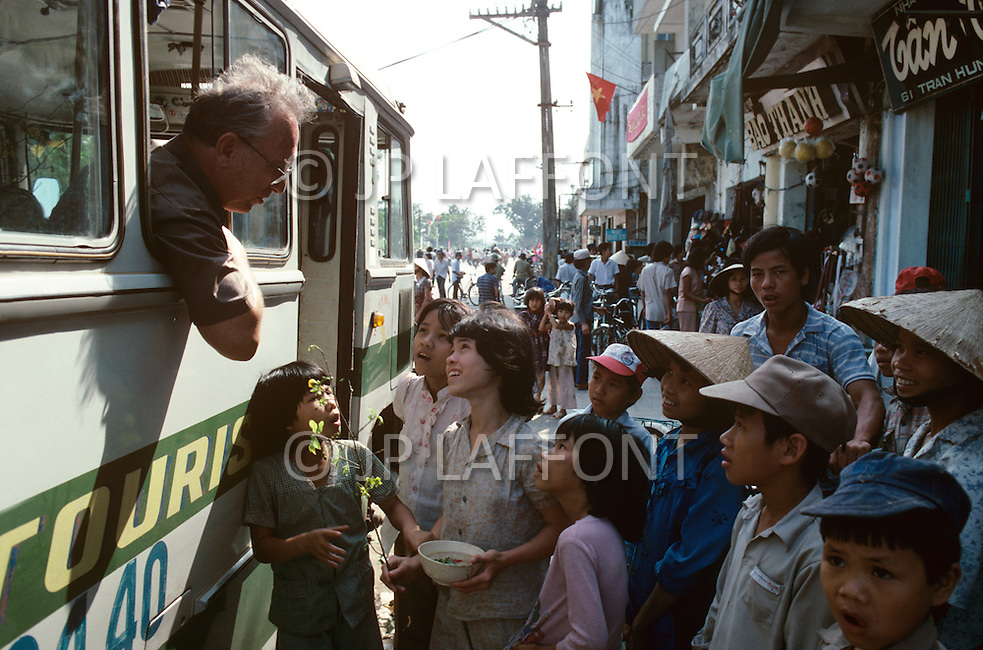 In Ho Chi Minh City, Saigon, February 1988. Contact between american Vietnam Veterans and pedestrians.