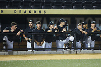 The Wake Forest Demon Deacons dugout watches the action during the game against the Virginia Cavaliers at David F. Couch Ballpark on May 18, 2018 in  Winston-Salem, North Carolina.  The Cavaliers defeated the Demon Deacons 15-3.  (Brian Westerholt/Four Seam Images)