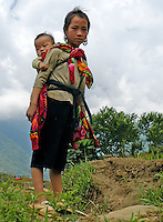 Young Hmong girl with baby near Sapa Vietnam