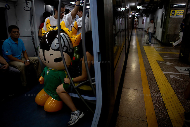An inflatable Olympic mascot gets carried onto the subway in Beijing, China on Wednesday, August 20, 2008.  Kevin German
