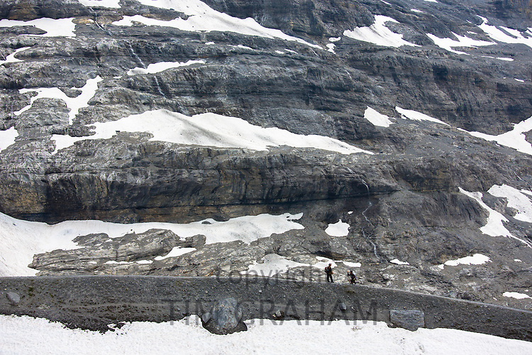 Hikers on the Eiger Trail near the Eiger Glacier, Eigergletscher, in Swiss Alps, Bernese Oberland, Switzerland