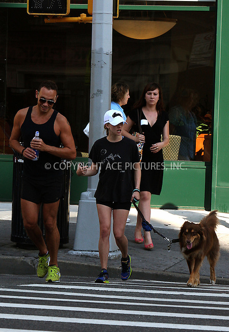 WWW.ACEPIXS.COM....August 28 2012, New York City....Actress Amanda Seyfried and freind set out out for a run with her dog Finn. Finn brings the run to a halt for a bathroon break which Amanada dutifully scoops up with a plastic bag on August 28 2012 in New York City......By Line: Philip Vaughan/ACE Pictures....ACE Pictures, Inc...tel: 646 769 0430..Email: info@acepixs.com..www.acepixs.com