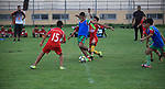 Palestinian children compete in a football match during youth championship organized by the Ministry of sport and youth, in Gaza city on September 12, 2019. Photo by Mahmoud Ajjour
