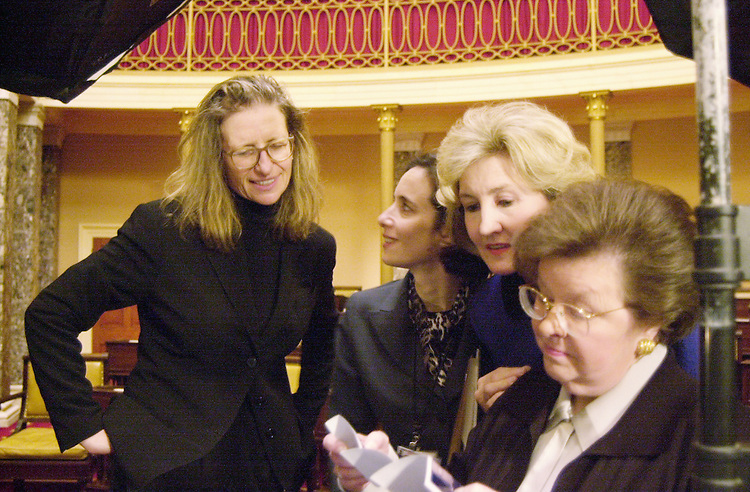 February, 2000: Annie Leibovitz looks at a photo proof with Kay Bailey Hutchison and Babara Milkulski and Mikulski's Chief of Staff Jenny Luray. (Rebecca Roth/Roll Call)