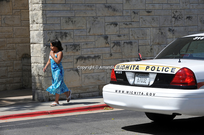 A girl leaves College Hill United Methodist Church under heavy security after the funeral for assassinated abortion doctor George Tiller in Wichita, Kansas on June 6, 2009.  Tiller was gunned down while serving as an usher at his church last Sunday by Scott Roeder, who is now in custody, in a political crime with reverberations across the region and the country; Tiller's Wichita clinic had previously served as a culture wars flashpoint in the 1990s.