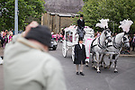 © Joel Goodman - 07973 332324 . 09/08/2013 . Salford , UK . A man watching the horse drawn cortege leaving the church bows his head and lifts his hat . The funeral of Linzi Ashton at St Paul's C of E Church in Salford , today (9th August 2013) . Linzi Ashton (25) was found murdered in her home on Westbourne Road in Salford on 29th June . Michael Cope is standing trial, accused of murdering, raping and assaulting her . Photo credit : Joel Goodman