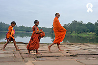 Three young monks going to beg for food (Licence this image exclusively with Getty: http://www.gettyimages.com/detail/84430547 )