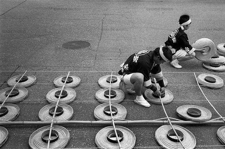 Kanto Festival in Akita. Men prepare a 12 meter long bamboo with 46 Japanese paper lanterns which weigh about 50kg.