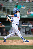 South Bend Cubs shortstop Andy Weber (24) follows through on his swing against the Lake County Captains on May 30, 2019 at Four Winds Field in South Bend, Indiana. The Captains defeated the Cubs 5-1.  (Andrew Woolley/Four Seam Images)