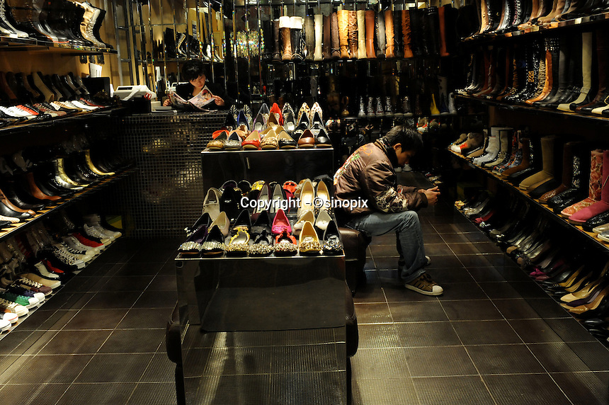 A nicely displayed shoe shop in downtown Shanghai, China..23 Jan 2010