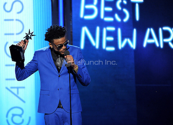 LOS ANGELES, CA - JUNE 29 : August Alsina accepts the Best New Artist award onstage at the BET Awards '14 at Nokia Theatre L.A. Live on June 29, 2014 in Los Angeles, California. Credit: PGMicelotta/MediaPunch