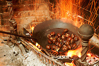 Chestnuts roasting on an open fire.  Weathersfield Inn, Weathersfield, VT.  New England USA
