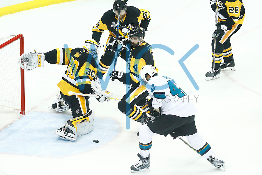 Matt Murray #30 of the Pittsburgh Penguins makes a save on Joel Ward #42 of the San Jose Sharks in the first period during game five of the Stanley Cup Final at Consol Energy Center in Pittsburgh, Pennsylvania on June 9, 2016. (Photo by Jared Wickerham / DKPS)