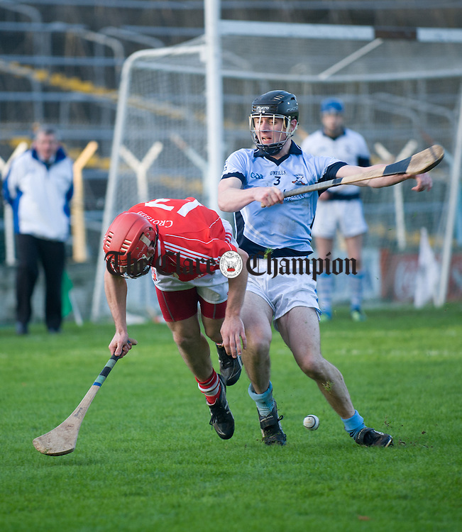 Patrick Meaney of Crusheen in action against Kieran Breen of Na Piarsaigh during their Munster Club final at Thurles. Photograph by John Kelly.