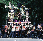 Wagon teams struggle to move their wagon during the Colliding Float Festival in Kakunodate, Japan. Each of the 15 massive five-ton wooden wagons, decorated to look like a sacred mountain, are pushed and pulled throughout the narrow streets of this samauri town. When meeting one another in opposite directions, a negotiation team is sent out to haggle over right of way. If this fails, the wagons are then crashed into one another. The Colliding Float Festival dates back to the 18th century when residents in this small farming village held a three-day festival in September to honor the gods for a bountiful harvest. (Jim Bryant Photo).....