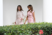 First lady Melania Trump and Queen Rania of Jordan walk  the colonnade of the White House on June 25, 2018. <br /> Credit: Olivier Douliery / Pool via CNP