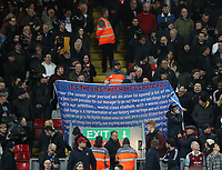 24th February 2020; Anfield, Liverpool, Merseyside, England; English Premier League Football, Liverpool versus West Ham United; West Ham fans display banners protesting at the ownership of the club