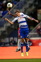 Blas Perez (7) of FC Dallas goes up for a header with Jamison Olave (4) of the New York Red Bulls. The New York Red Bulls defeated FC Dallas 1-0 during a Major League Soccer (MLS) match at Red Bull Arena in Harrison, NJ, on September 22, 2013.