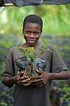 Nigenson Dupres, 15, holds seedlings in a plant nursery in Despagne, a rural village in southern Haiti where the Lutheran World Federation has been working with residents to improve their quality of life. The LWF-sponsored nursery provides plant which residents use to fight deforestation.