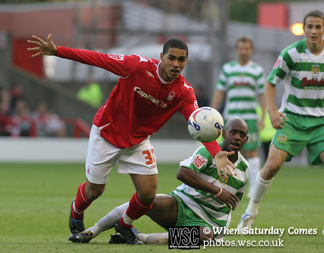 Nottingham Forest 2 Yeovil Town 5, 18/05/2007. City Ground, League One Play Off Semi Final 2nd Leg. Nottingham Forest's Lewis McGugan is challenged by Yeovil Town's Tyrell Forbes during the League One play-off semi-final match at the City Ground. Forest had won the first leg by 2 goals to nil at Yeovil the previous week but were defeated by 5 goals to 2 after extra time and missed out on the play-off final at Wembley. Yeovil went on to play Blackpool in the final for the one remaining promotion place to the Championship. Photo by Colin McPherson.