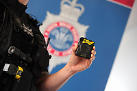 One of the AXON bodycams held by a firearms police officer. Wednesday 17 May 2017<br /> Re: Body worn video cameras are being introduced into the South Wales Police force as part of operational equipment and will be rolled out over the next few months.<br />  Forces across the UK are using this technology and integrating it into daily policing activities.  Body worn video may be used in court as evidence and for investigative purposes, including complaints against police or as a training material for police. <br />  Other forces have seen a range of benefits from using body worn video to support their general patrolling and investigative tasks. These benefits include:<br /> Gathering and presentation of evidence<br /> Changing the behaviour of offenders<br /> Lower incidence or escalation of violence<br /> Increased guilty pleas by defendants<br /> Increased time on patrol and less time spent on paperwork<br /> Improved public co-operation and interactions with police<br /> Improved transparency and accountability<br /> Professionalising police interaction<br /> Assistant Chief Constable Richard Lewis said: &ldquo;Equipping our officers with body worn cameras is the start of a new way we capture, utilise and share digital evidence.  The technology is very exciting and will assist officers and staff in doing their jobs, it will ensure that we are more accountable to the public that we serve and in turn build trust with our communities.