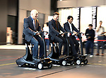 """September 29, 2017, Tokyo, Japan - Former Formula 1 driver Ukyo Katayama (R), Australian journalist Peter Lyon (C) and American journalist Morley Robertson (L) drive eleectric personal mobility """"Landboard"""" developed by Japanese automobile venture Exmachina at a press preview in Tokyo on Friday, September 29, 2017. Exmachina also displayed two-seater electric vehicle Earth-1 which enables to transform its body like a robot.   (Photo by Yoshio Tsunoda/AFLO) LWX -ytd-"""