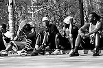 "April 17th 2005. New York, New York. United States..Located in the heart of Greenwich Village, the West 4th Street basketball Court, known as ""The Cage"", offers no seating but attracts the best players and a lot of spectators as soon as spring is around the corner..Half the size of a regular basketball court, it creates a fast, high level of play. The more people watch, the more intense the games get. « The Cage » is a free show. Amazing actions, insults and fights sometimes, create tensions among and inside the teams. The strongest impose their rules. Charisma is present..""The Cage"" is a microcosm. It's a meeting point for the African American street culture of New York. Often originally from Jamaica or other islands of the Caribbean, they hang out, talk, joke, laugh, comment the game, smoke… Whether they play or not, they're here, inside ""The Cage"". Everybody knows everybody, they all greet each other, they shake hands and hug: ""Yo, whasup man?"""