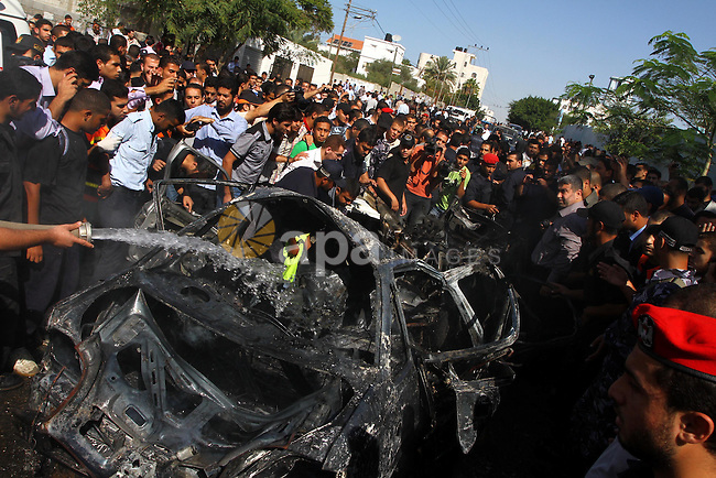 A member of Hamas' security forces extinguishes a fire from a car that exploded in Gaza City November 3, 2010. The car exploded outside a police headquarters in the city of Gaza on Wednesday, killing one Palestinian, Hamas officials and witnesses said. The Hamas Interior Ministry said the explosion was caused by an Israeli air strike . Photo by Ashraf Amra