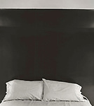 Scan of vintage print. Two pillows on bed. 79-173-5. 1979.