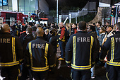 Firefighters on the route of a monthly silent vigil commemorating the victims of the Grenfell Tower fire, North Kensington, London.