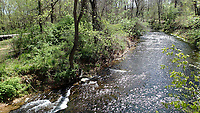 NWA Democrat-Gazette/FLIP PUTTHOFF <br />Spring Creek is seen from a bridge on a spur trail off the Razorback Greenway at the Springdale trailhead along Silent Grove Road.