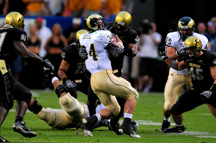 31 Aug 2008: Colorado State running back Kyle Bell (34) is stopped by Colorado linebacker Brad Jones. The Colorado Buffaloes defeated the Colorado State Rams 38-17 at Invesco Field at Mile High in Denver, Colorado. FOR EDITORIAL USE ONLY
