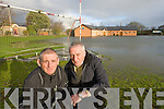 Mike Sugrue and Jimmy Mulligan at the flooding at Saint Pat's Gaa club in Blennerville on Monday.