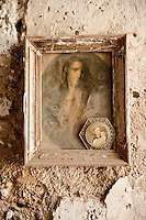Antique religious painting covered in dust at the entrance to 'Parco delle Zagare', lemon grove of Luigi Aceto, Amalfi, Italy