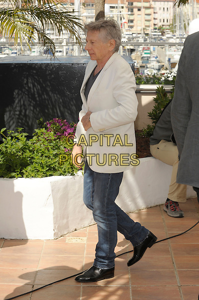 Roman Polanski.'La Venus A La Fourrure'  photocall at the 66th Cannes Film Festival, France 23rd May 2013.full length grey gray top jeans denim profile white suit jacket side .CAP/PL.©Phil Loftus/Capital Pictures.