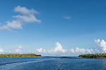 Apataki Atoll, Tuamotu Archipelago, French Polynesia; view of  the palm tree covered islands bordering Tehere Pass from inside the channel on Apataki Atoll