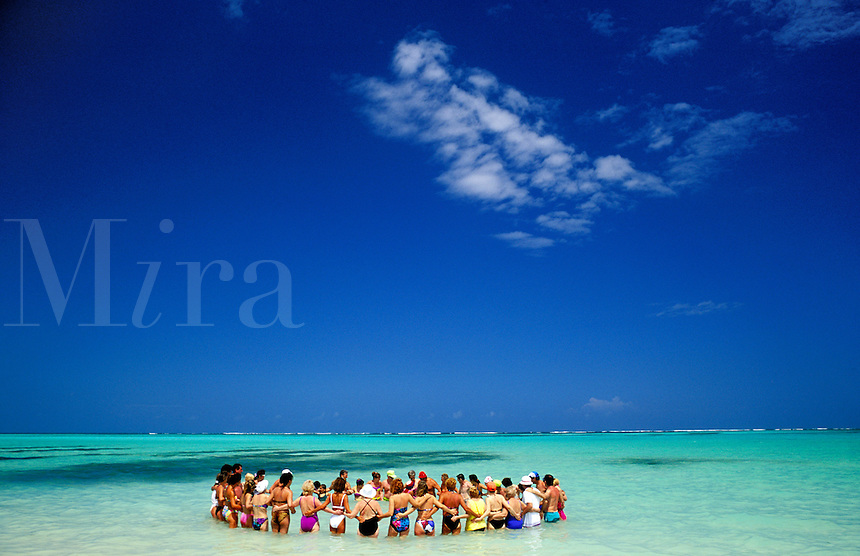 Dominican Republic, Punta Cana, Bavaro Beach. Group of people forming a circle in the Caribbean Sea
