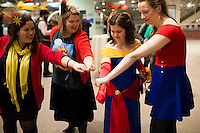 Fans of the Captain Marvel and Ms. Marvel comics, L-R, Pippa Adams, Jennifer DePrey, Ari Crossby and Lucy Bowden demonstrate their secret handshake during the Carol Corps Celebration Thursday March 27, 2014 at the Museum of Flight in Seattle. Held the day before Emerald City Comicon kicked off, the event raised funds for Girls Leadership Institute and offered a chance for fans to meet and chat with Captain Marvel writer Kelly Sue DeConnick and Ms. Marvel writer G. Willow Wilson. Photo by Daniel Berman for WIRED.com