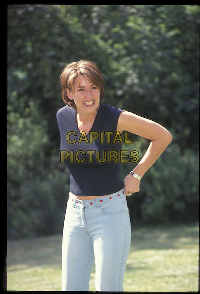 CLAIRE SWEENEY.30 May 2001.Ref: 10878.pulling trousers up, half length, half-length.*RAW SCAN- photo will be adjusted for publication*.www.capitalpictures.com.sales@capitalpictures.com.©Capital Pictures