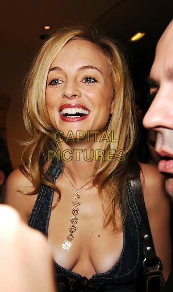 HEATHER GRAHAM.Diesel - store launch party, Diesel, 130 New Bond Street, London, UK..May 18th, 2006.Ref: CAN.headshot portrait denim jeans jean plunging neckline cleavage necklace.www.capitalpictures.com.sales@capitalpictures.com.© Capital Pictures.