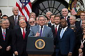 United States House of Representatives Majority Whip Kevin McCarthy, Republican of California, speaks on the South Lawn of the White House surrounded by United States President Donald J. Trump, United States Vice President Mike Pence, and Republican members of Congress after the United States Congress passed the Republican sponsored tax reform bill, the 'Tax Cuts and Jobs Act' in Washington, D.C. on December 20th, 2017. Credit: Alex Edelman / CNP