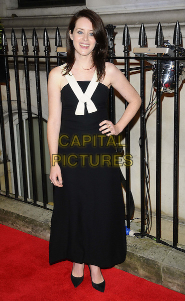 Claire Foy<br /> The Luminous BFI gala dinner &amp; auction, 8 Northumberland Avenue, Northumberland Avenue, London, England.<br /> October 8th, 2013<br /> full length black dress white hand on hip<br /> CAP/CAN<br /> &copy;Can Nguyen/Capital Pictures