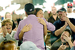 Rock Star Treatment: During a break, Daniel Negreanu wandered over to another tournmaent area. There, a girl named, Traci, saw him and started crying.  She was so overcome.  Negreanu then came over and gave her a hug & autograph.