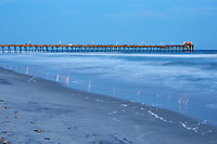 View of the fishing pier and ocean waves shortly after sunset in Atlantic Beach (note: fishing pier was damaged by Hurricane Florence less than six months after this photo was taken)