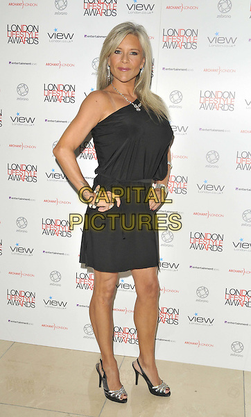 Samantha Fox .The London Lifestyle Awards 2011, Park Plaza Riverbank hotel, Albert Embankment, London, England..October 6th, 2011.full length black dress hands on hips one shoulder sleeve sam.CAP/CAN.©Can Nguyen/Capital Pictures.