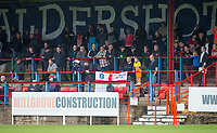 Both sets of supporters sit together during the pre season friendly match between Aldershot Town and Wycombe Wanderers at the EBB Stadium, Aldershot, England on 22 July 2017. Photo by Andy Rowland.